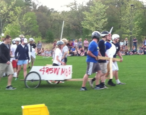 Racers made a grand entrance by circling the field before the start of the games.