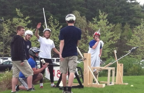 Teams used medieval-style slingshots and catapults that they built to try to hit a target.